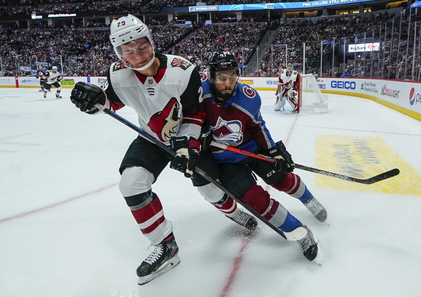 Arizona Coyotes center Barrett Hayton (29) and Colorado Avalanche left wing Pierre-Edouard Bellemare (41) fight for position during the first period of an NHL hockey game, Saturday, Oct. 12, 2019, in Denver. (AP Photo/Jack Dempsey)