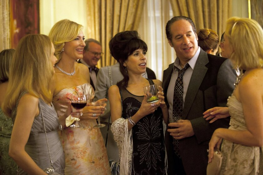 """In this film image released by Sony Pictures Classics shows, from second left, Cate Blanchette, Sally Hawkins, and Andrew Dice Clay in a scene from the Woody Allen film, """"Blue Jasmine."""" """"Blue Jasmine,"""" """"Nebraska"""" and """"American Hustle"""" have been nominated for Writers Guild honors, continuing their imprint on Hollywood's awards season. The three comedies gained nods on Friday, Jan. 3, 2014, for exceptional screen writing. (AP Photo/Sony Pictures Classics)"""
