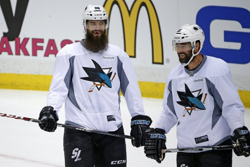 San Jose Sharks' Brent Burns (88), and Patrick Marleau, right, participate in a hockey practice at the Consol Energy Center in Pittsburgh, Sunday May 29, 2016. The Sharks are preparing for Game 1 of the Stanley Cup Finals against the Pittsburgh Penguins on Monday, May 30, in Pittsburgh. (AP Photo/G