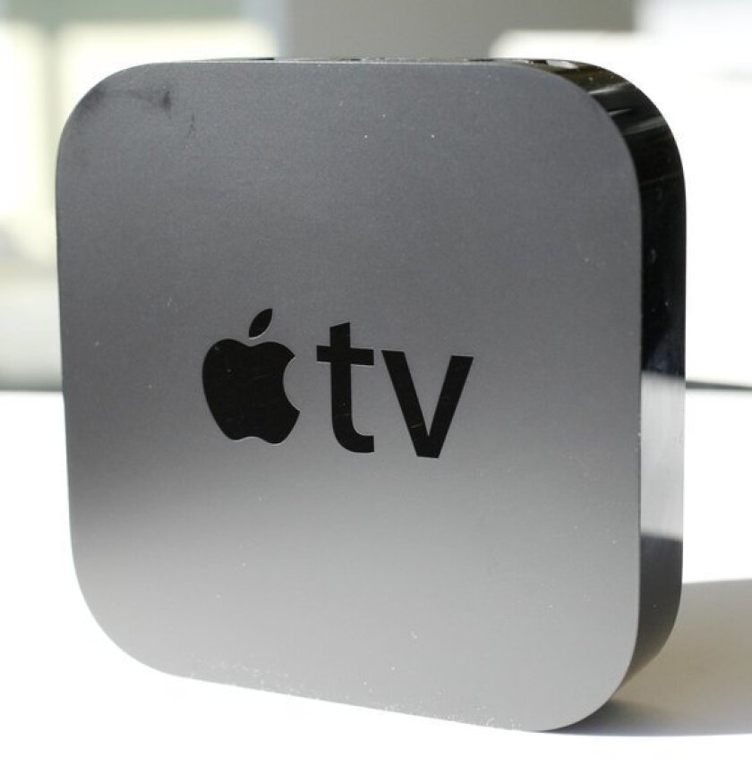 Apple CEO Tim Cook hints that the company plans to make its own TV set. The firm currently sells its Apple TV device, above, which connects to a TV.