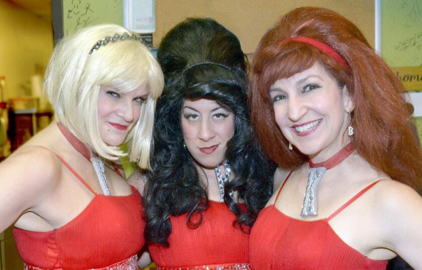 In their dressing room prior to hosting Flappers New Year's Eve show are The Boobé Sisters – Heather Stewart, from left, Leah Finkelstein and Karen Volpe.
