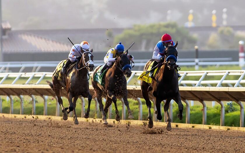 Princess Noor and jockey Victor Espinoza, right, draw away and go on to win the Grade I $250,000 Del Mar Debutante.