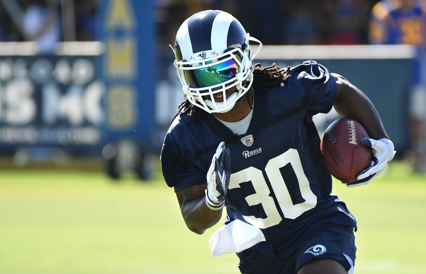 Rams running back Todd Gurley carries the ball during the opening of training camp at UC Irvine on Saturday.