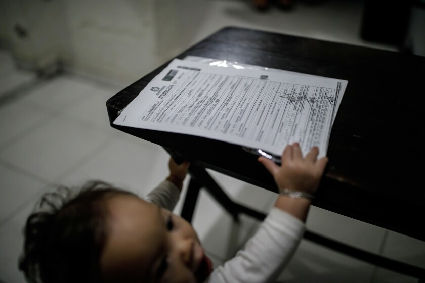 BOGOTA, D.C. -- WEDNESDAY, MAY 1, 2019: Jose Luis Zambrano Nunez, 9 months old, reaches for his Colo