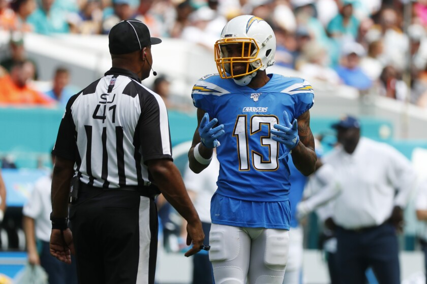 Keenan Allen complains about offensive pass interference called against him during the Chargers' game in Miami.