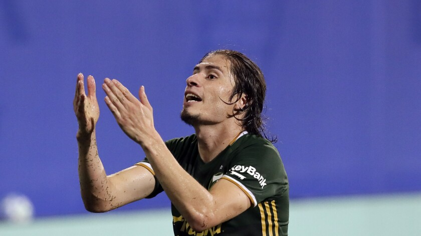 Portland Timbers defender Jorge Villafana disputes a ruling by officials on Aug. 5, 2020, in Kissimmee, Fla.
