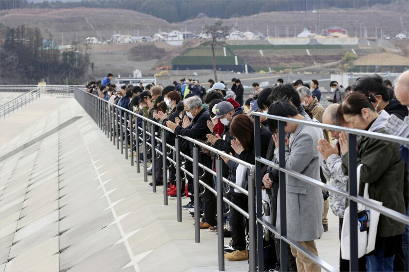 People in the northern Japan observe a moment of silence March 11 for victims of the 2011 tsunami.