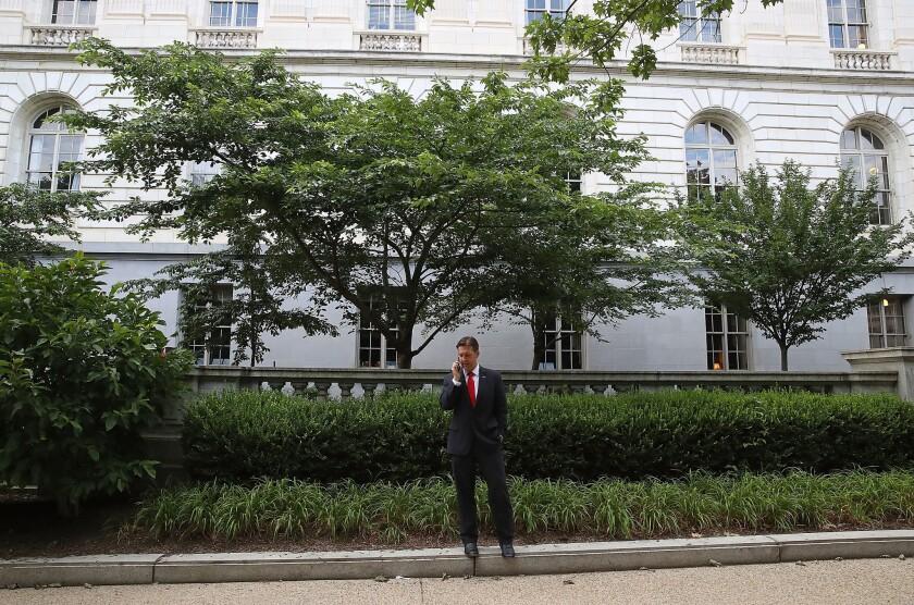 Sen. Ben Sasse (R-Neb.) talks on his phone outside the Senate office buildings on Capitol Hill.