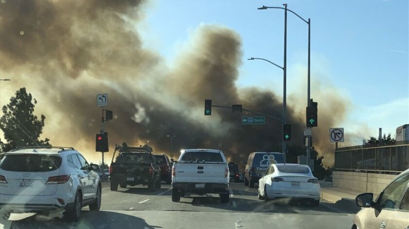 Smoke rises from a fire in the Sepulveda Basin on Thursday.