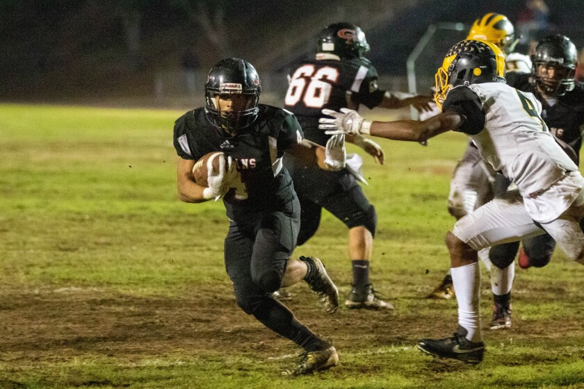 Erik Hernandez, runs the ball Friday night against Mission Bay during a 22-10 victory by Castle Park.