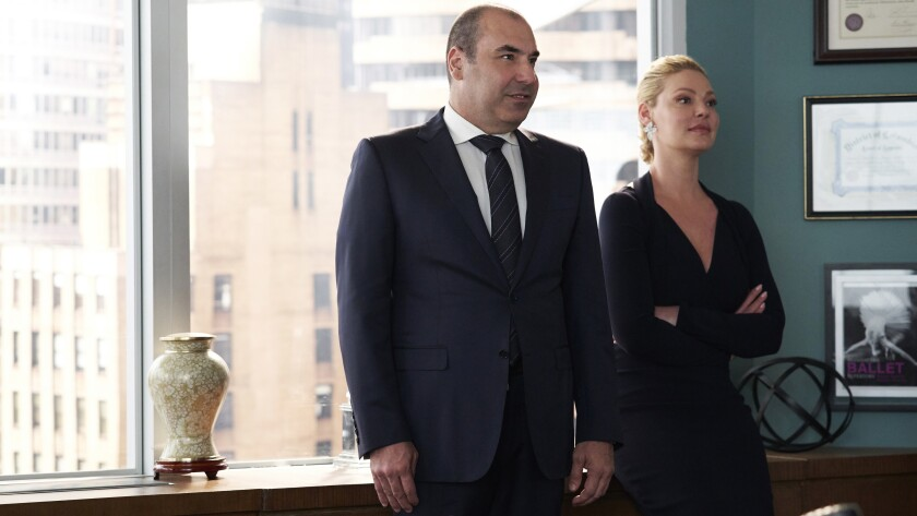 "Rick Hoffman and Katherine Heigl in ""Suits"" on USA."