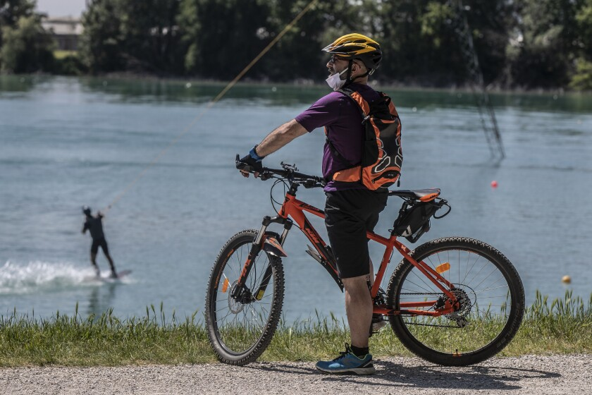 People enjoy the Idroscalo reservoir in Milan, Italy, on May 9 as nationwide lockdown measures to prevent the spread of the coronavirus were relaxed.