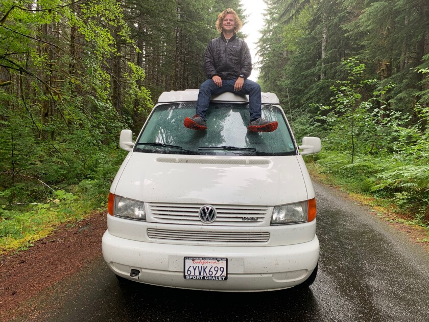 Morgan Willis sits atop his 2000 VW Eurovan Camper.