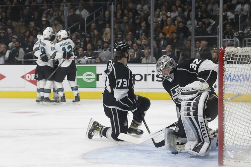 Kings goalie Jonathan Quick and forward Tyler Toffoli hang their heads after allowing a third period goal to Sharks forward Joonas Donskoi on April 22.