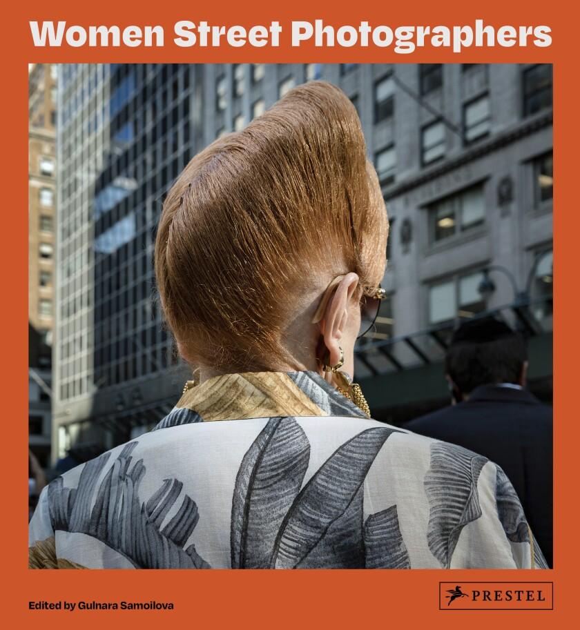 """This cover image released by Prestel shows """"Women Street Photographers,"""" a collection of photos edited by Gulnara Samoilova. (Prestel via AP)"""