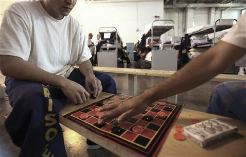 Inmates play checkers in a gymnasium converted to house prisoners at the California Substance Abuse Treatment Facility and State Prison in Corcoran on Wednesday, Jan. 14, 2009.