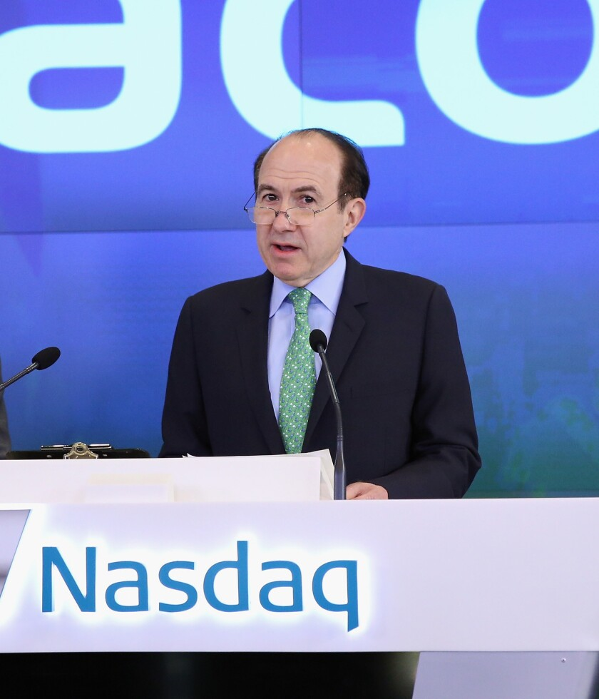 Viacom said it has acquired a 50% stake in Prism TV, an Indian TV group. Viacom CEO Philippe Dauman is shown ringing the NASDAQ opening bell in June.