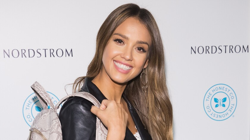 Actress and Honest Beauty co-founder Jessica Alba poses for a photo with the Honest Co. brand backpack at Nordstrom Downtown Seattle on Aug. 4 in Seattle.