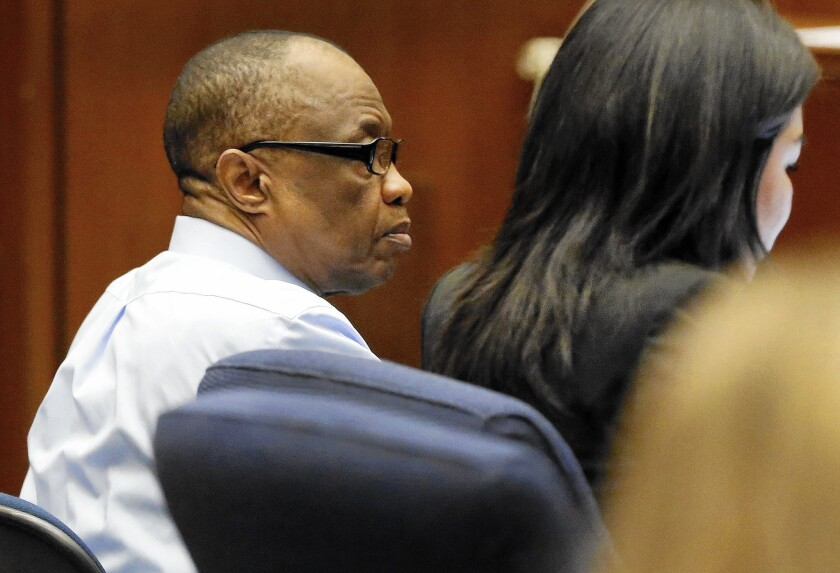 Lonnie Franklin Jr., with defense attorney Kristen Gozawa, in February during opening statements in his murder trial.
