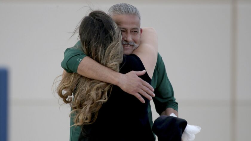 Romulo Avelica-Gonzalez embraces daughter Brenda after being released from the Adelanto Detention Fa