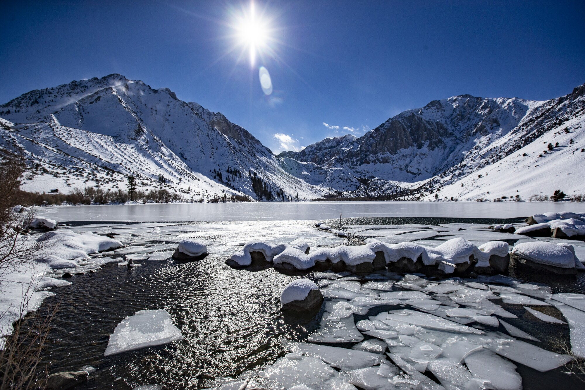 Ice breaks up at the mouth of Convict Creek overlooking Convict Lake and the Sierra Nevada range near Mammoth Lakes.