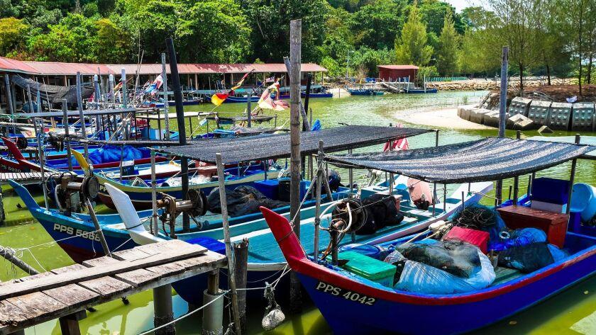 Fishing boats on the Island of Penang, Malaysia.