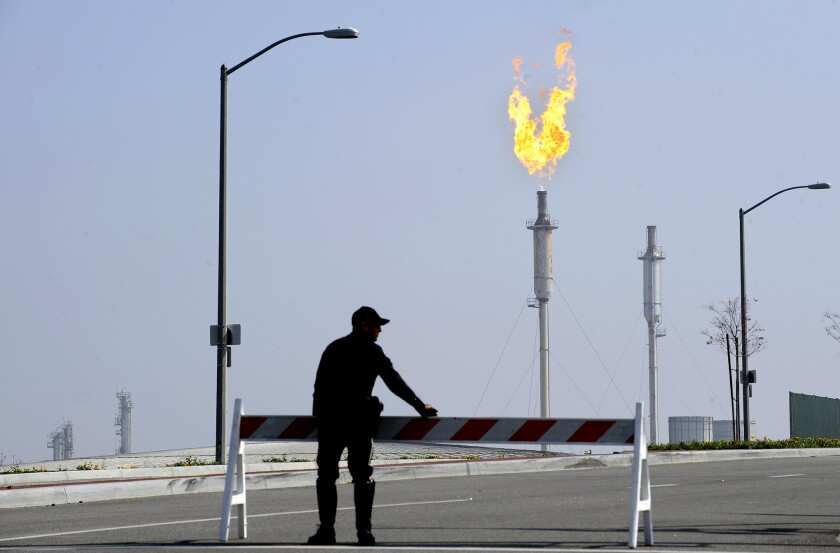 Torrance police close off Del Amo Boulevard near the Exxon Mobil Refinery in Torrance following an explosion Feb. 19.