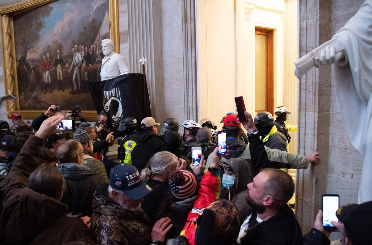 Supporters of US President Donald Trump protest in the US Capitol's Rotunda on January 6, 2021, in Washington, DC. - Demonstrators breeched security and entered the Capitol as Congress debated the a 2020 presidential election Electoral Vote Certification. (Photo by SAUL LOEB / AFP) (Photo by SAUL LOEB/AFP via Getty Images)