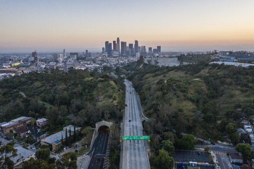 The 110 Freeway leads south toward downtown Los Angeles.