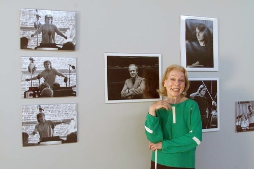 """Betty Freeman, pictured with an exhibit of her photographs, made more than 400 grants and commissions over the last four decades to help composers, whom she called """"the most important people."""""""