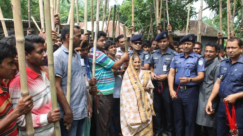 Police in western Bangladesh have armed villagers with bamboo sticks and whistles in an effort to deter Islamist militants from attacking people of minority faiths.