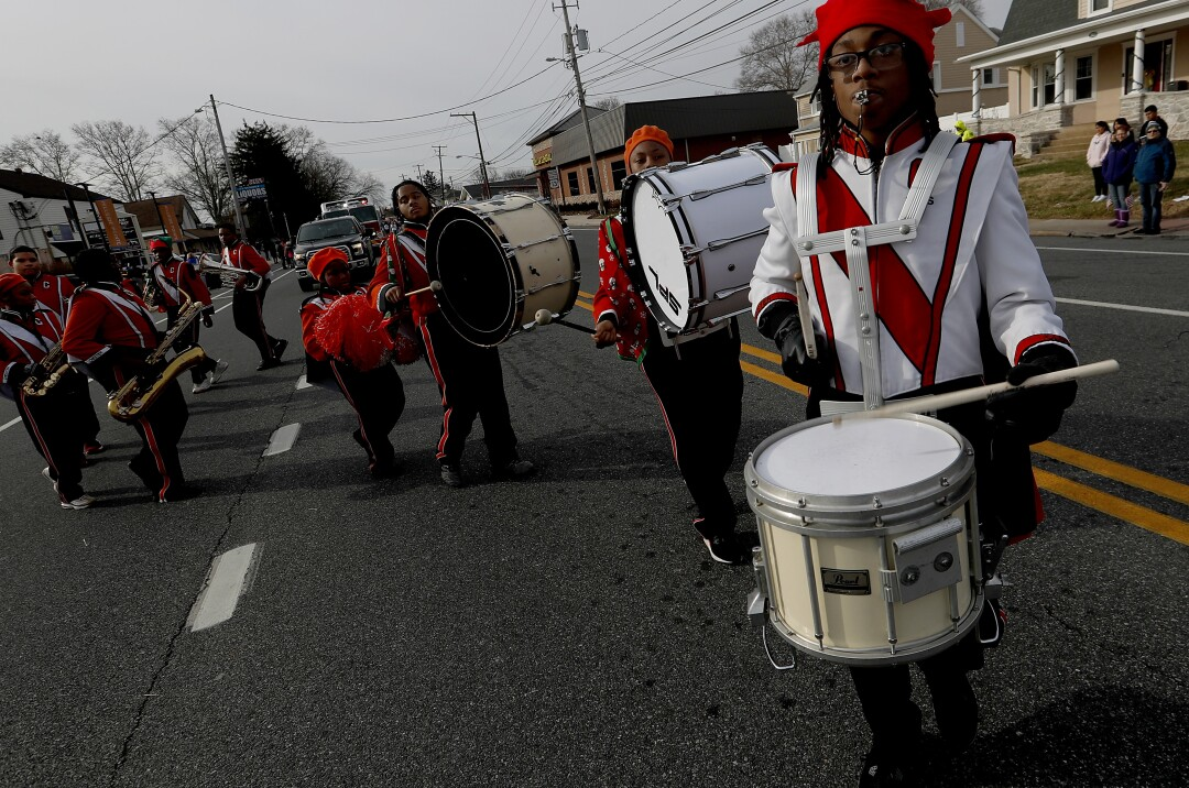 A high school marching band participates in a parade in the Wilmington suburb of Claymont.