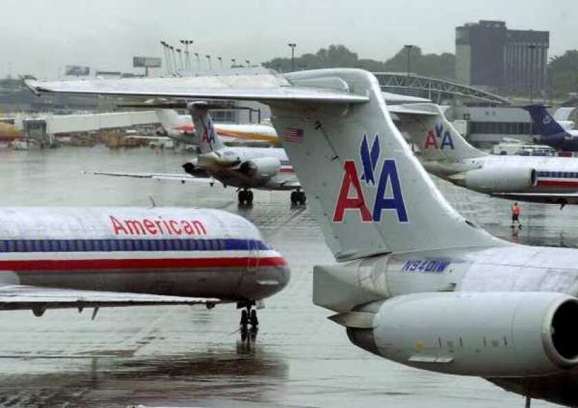 American Airlines passenger aircraft at Lambert International Airport in St. Louis. The airline's parent, AMR, reported a $1.7 billion loss in the first quarter.
