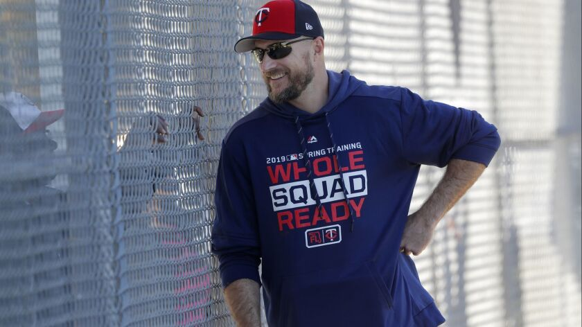 Minnesota Twins manager Rocco Baldelli talks through a fence as pitchers and catchers report for their first workout at their spring training baseball facility in Ft. Myers, Fla., Thursday, Feb. 14, 2019.