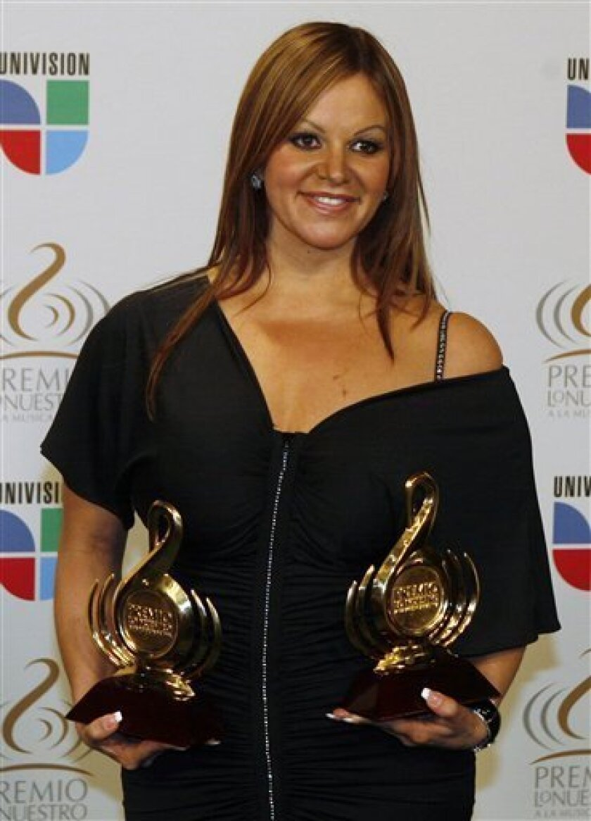 FILE -- In this Thursday March 26, 2009 file photo Mexican singer Jenni Rivera poses backstage during the Premio Lo Nuestro Latin music awards in Coral Gables, Fla.  Rivera was arrested Monday at Mexico City International airport for not declaring  that she was carrying around $ 50.000 in cash  bef