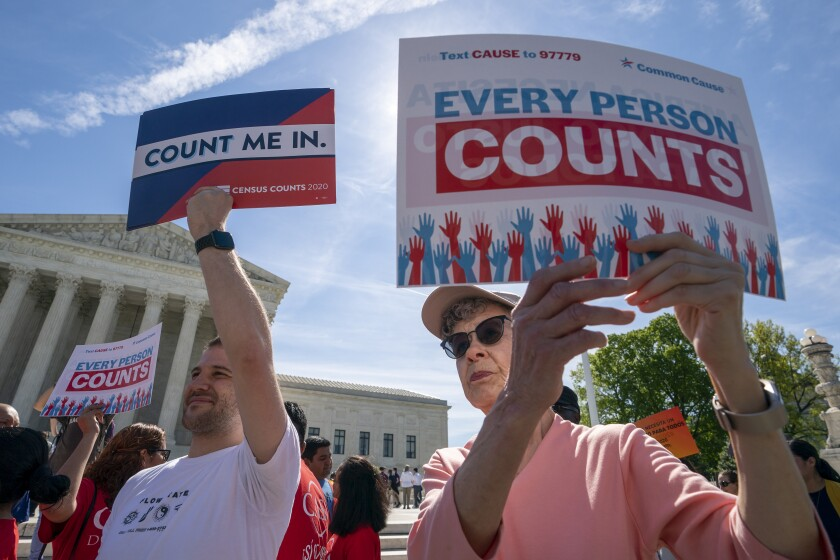 FILE - In this April 2019 file photo activists rally outside the Supreme Court as justices hear arguments about the Trump administration's plan to ask about citizenship on the 2020 Census. (AP Photo/J. Scott Applewhite, File)