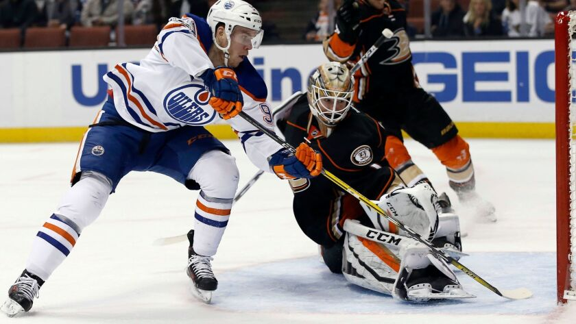 Oilers center Connor McDavid scores against Ducks goalie Jonathan Bernier during a game this season.