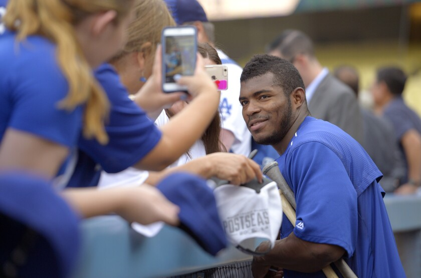 Dodgers' Yasiel Puig poses for photos before a Sept. 21 game against Arizona.