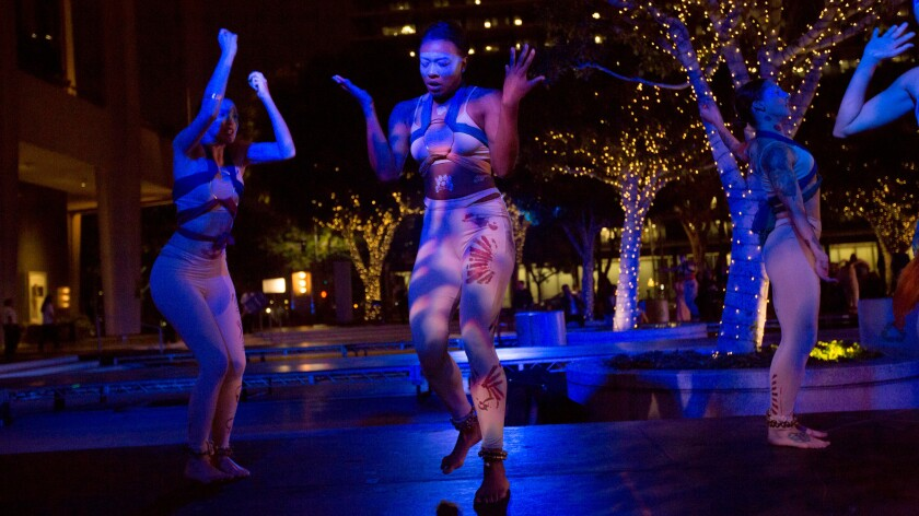 """Blue13 Dance Company performs """"Among Whispers"""" on the Music Center Plaza during the Moves After Dark program Monday."""