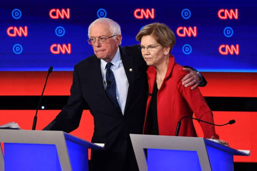 Democratic candidates Bernie Sanders and Elizabeth Warren after a presidential debate in July.