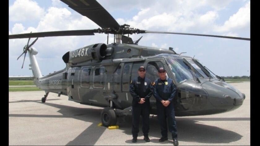 San Diego Fire-Rescue Senior Pilot Chris Hartnell (left) and Chief Chuck Macfarland accepted the department's first S-70 Black Hawk helicopter in June.
