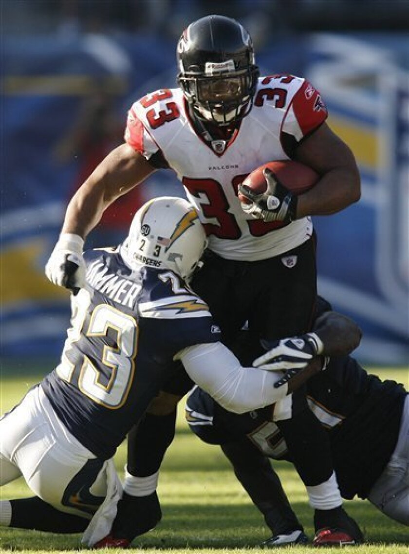 As a result of losing free agents Michael Turner, above, and Drayton Florence, the Chargers were awarded two compensatory picks at the end of the fourth round of April's draft.
