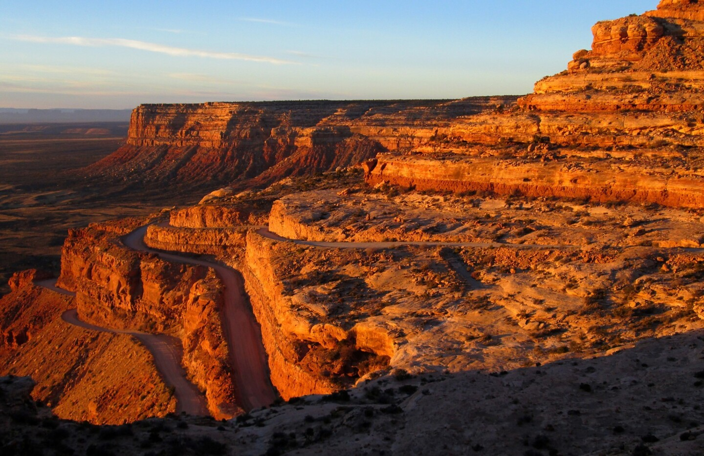 A modern road ascends its way to Cedar Mesa, home to one of the largest collections of pre-Columbian ruins in the United States, in southeastern Utah.