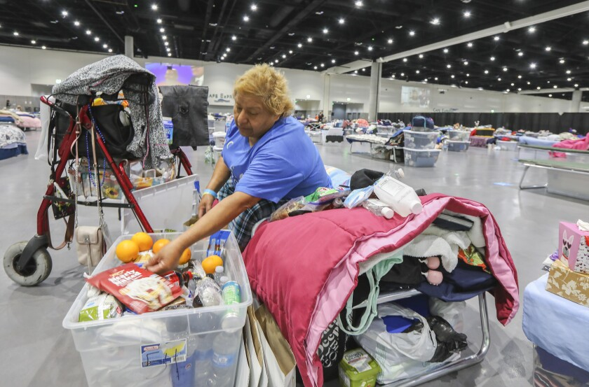 Letisha Vazquez went through her belongings at the homeless shelter in the San Diego Convention Center in June.