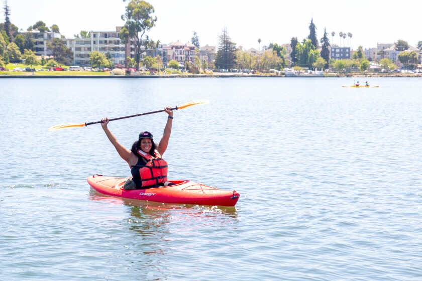 Rue Mapp, seated in a kayak