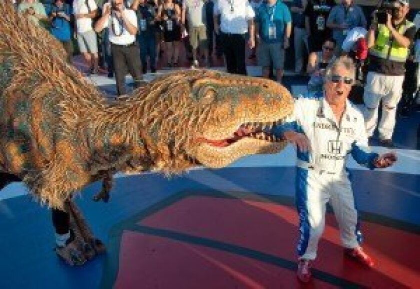 """Baby T-Rex from """"Walking with Dinosaurs"""" snacking on Mario Andretti"""