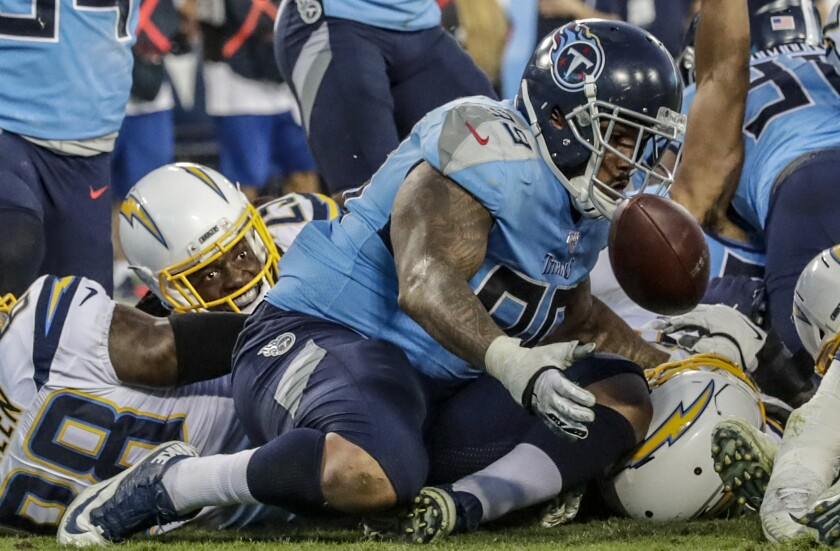 NASHVILLE, TN, SUNDAY, OCTOBER 20, 2019 - Los Angeles Chargers running back Melvin Gordon (25) can only watch as Tennessee Titans defensive end Jurrell Casey (99) collects his fumbled ball at the goal line at Nissan Stadium. (Robert Gauthier/Los Angeles Times)