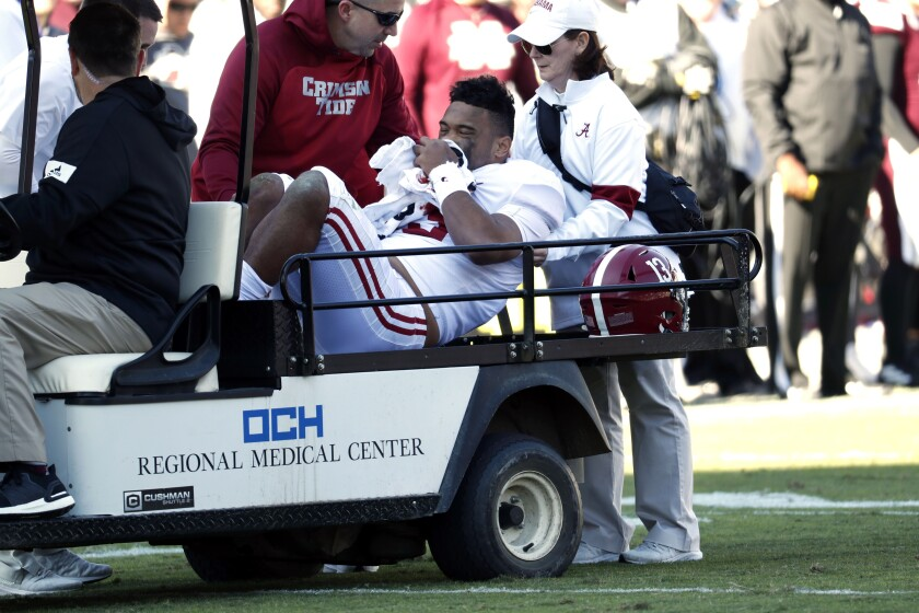 Alabama quarterback Tua Tagovailoa is carted off the field after getting injured against Mississippi State.