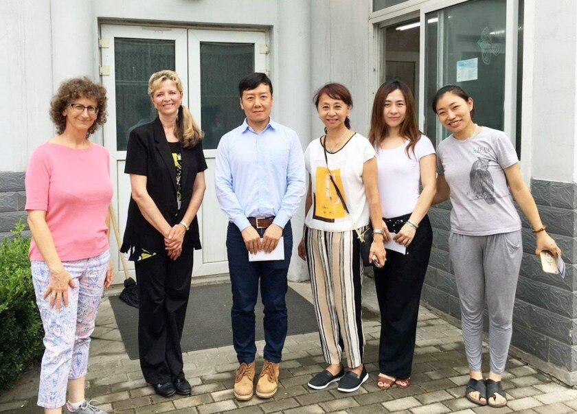 Artistic Director Ulli Reiner, second from left, visited the Beijing Raptor Rescue Center while in China. Reiner said she is heavily involve din wildlife conservation, especially raptor conservation.