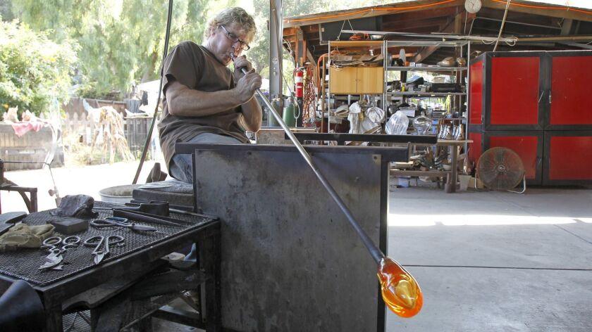 Glass artist Gavin Heath demonstrates the art of glass blowing in his Laguna Canyon studio. Heath wi